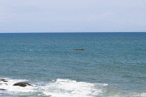 small fishing boat in the ocean at Cape Coast
