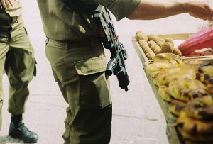 armed soldiers buying something to eat