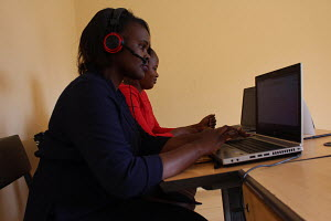 Susan Aching and Rebecca Oluoch in their work station at Lucky Summer in Nairobi
