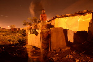 African child, red jersey, nightscape, Phola Park, corrugated iron housing, debris,