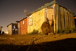 Nightscape, Phola Park, corrugated iron homes, Cable TV aerial