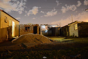 Phola park at night, Home under construction, builders sand, informal housing