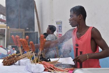 Man smoking and selling khebab