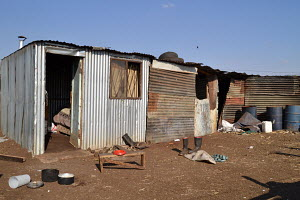Greenfield Corrugated Iron housing, Iron pot, gumboots, wooden stool