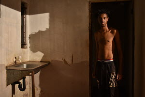 Self Portrait, house interior, shadows, sink, tap, house interior, nighttime, black male body topless
