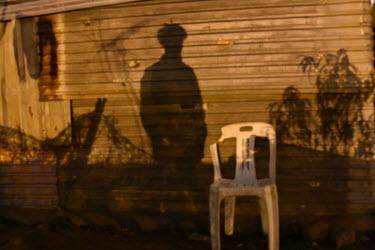 Phola Park, Ext 5, South of Johannesburg, Corrugated iron housing, Sundown, white plastic chair, shadows